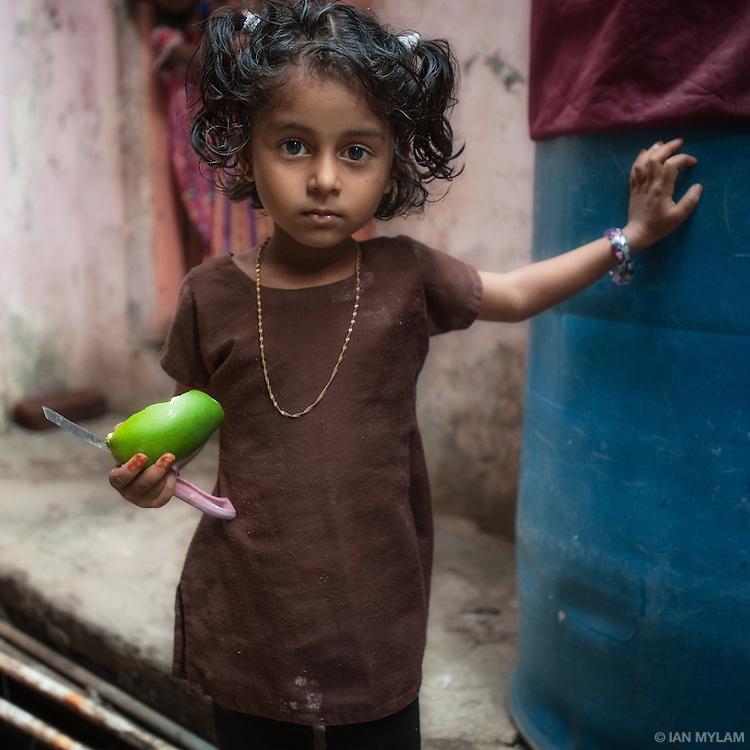 Girl with Fruit - Dharavi, Mumbai, India