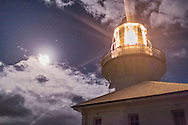 The Smoky Cape Lighthouse with its beams shining by the Moon and Mars, with Antares to the right of Mars above the Moon. This is near South West Rocks on the Mid-North Coast of New South Wales, Australia. Built in 1891, the Lighthouse was staffed until the 1980s when all lighthouses were automated. It was converted from kerosene to electric in 1962 when it was also increased to 1,000,000 candela output. It uses a Chance Brothers 4-metre 9-panel 920m catadioptric lens.<br /> <br /> This is a single exposure at 1/10 second and f/1.4 and ISO 6400 to stop the motion of the rotating beams.