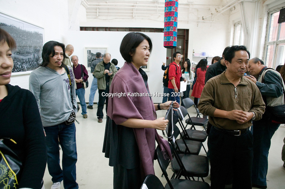 BEIJING, SEPT. 27:  Mao's Ur ( Gross???)Enkelin Kong Dongmei, 36, auf einer Vernissage im 798 Kunstviertel ...wikipedia wisdom:. According to Kong Dongmei (  granddaughter of Mao's daughter Li Min ), Mao's ex-wife He Zizhen ) was initially banned from visiting the mausoleum. The reason was never given by the Chinese government. After more than a year of repeated appealing and nearly two million people had already visited the mausoleum, He Zizhen was finally allowed for a single visit, with heavy restrictions: the visit must be secret and He Zizhen must not cry, not making any noise and must not talk to press to talk about the visit. He Zizhen was allowed to be photographed with her ex-husband's statue in the mausoleum by Lu Xiangyou (???), Mao's personal photographer since the late 1950's. Dr. Xu Jing (??), the author of the book titled The Place where a Great Man Rests documented the visit by important people to the mausoleum, but He Zizhen's visit on September 8, 1979 was not allowed by the Chinese government to be included in the book, and the reason is never given by the Chinese government.
