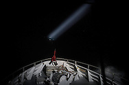 """Norwegian Redningsselskapet rescue boat """"Peter Henry Von Koss"""" conducts a Frontex sea patrol on the northern shores of Lesbos island on 29 February, 2016.  The boat executes it's patrol pattern during night time with help of a searchlight."""