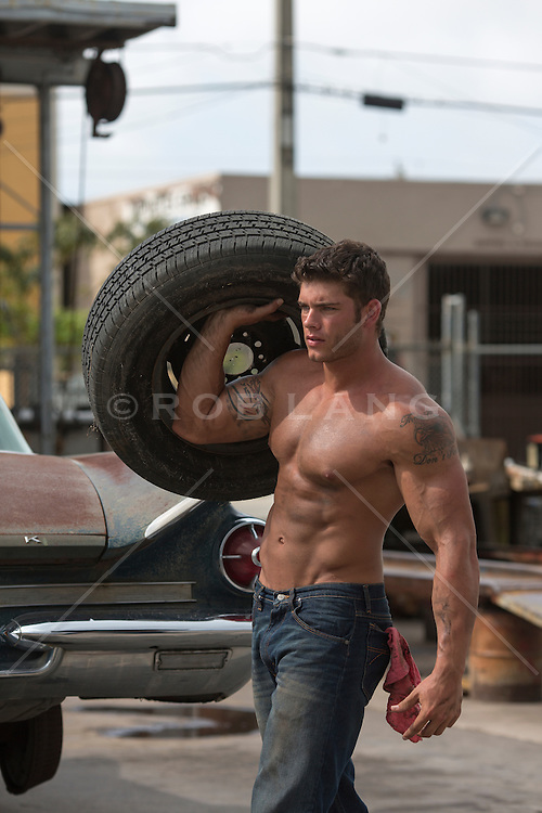 http://cdn.c.photoshelter.com/img-get2/I0000TEs9XJZsqdI/fit=1000x750/shirtless-man-carrying-a-tire-at-an-auto-repair-shop.jpg