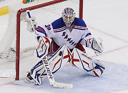 Oct 5, 2009; Newark, NJ, USA; New York Rangers goalie Henrik Lundqvist (30) watches the puck go wide of the net during the third period at the Prudential Center. The Rangers defeated the Devils 3-2.