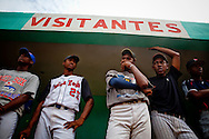 Players wait their turn to perform in a showcase for Major League Baseball scouts on Friday, February 26, 2010 in San Antonio de Guerra, Dominican Republic.