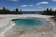 Pools at West Thumb Geyser Basin in Yellowstone National Park. The basin lies next to Yellowstone Lake, and the earth's crust is only 2 miles thick at this point