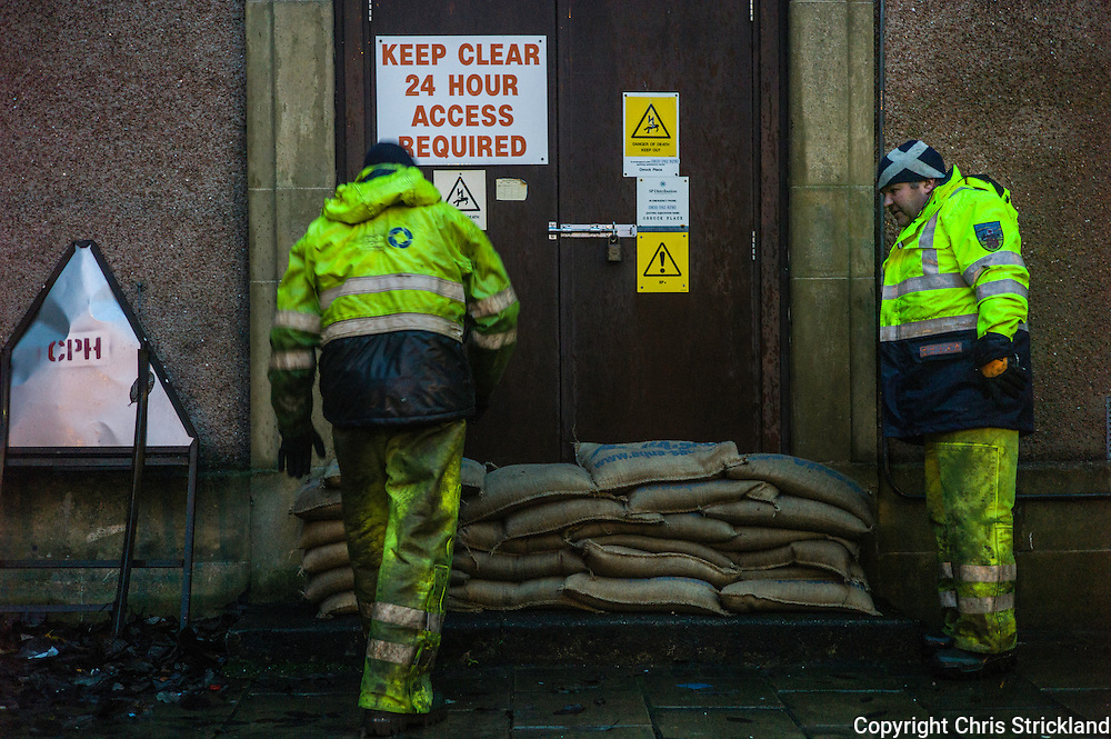 Hawick, Scotland, UK. 5th December 2015. Scottish Power workmen build sand bag barriers at sub stations in Hawick as the town prepares for flooding on Saturday night.