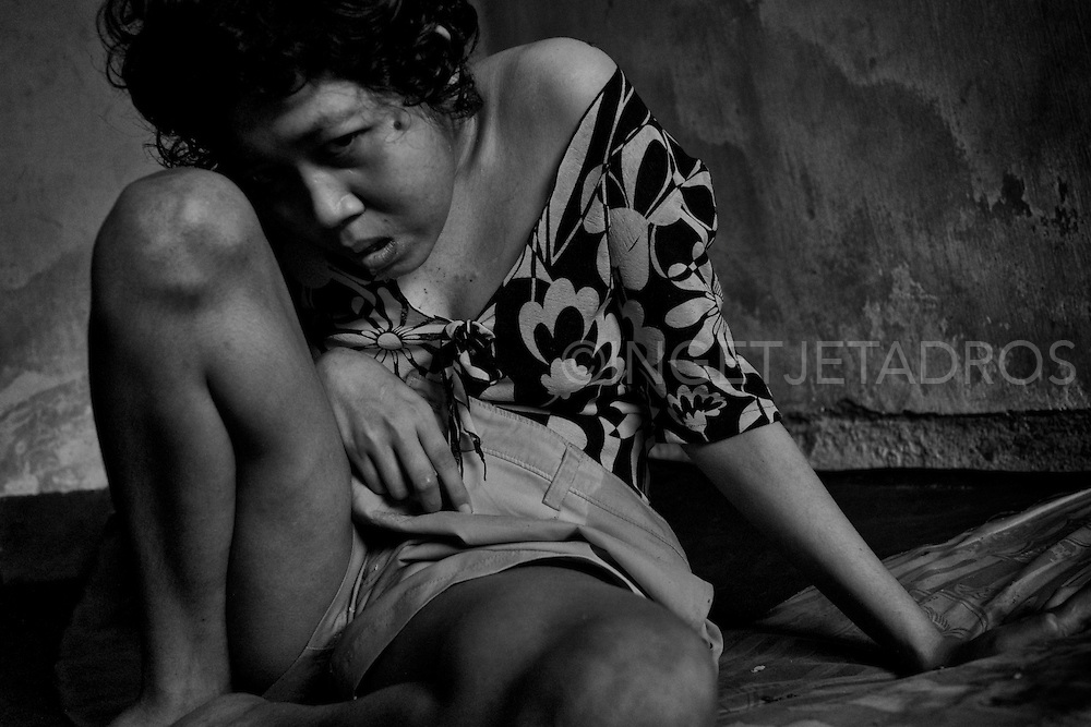 Komang is not able to talk or walk. Sometimes her pathologic laughter can be heart which sounds hollow from her dark and empty room. &copy;Ingetje Tadros/Diimex<br />