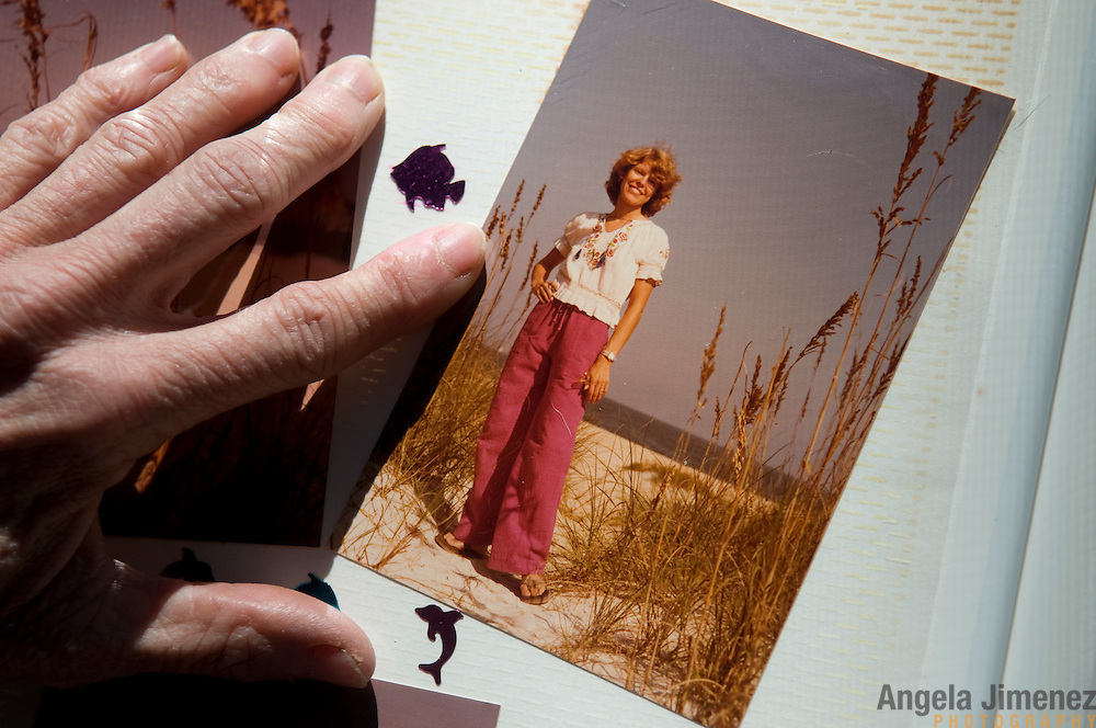 "Date: 1/09/09.Desk: STL.Slug: WOMYN.Assign ID: 30074969A..Emily Greene, 62, with an early 1980's era photo of herself from The Pagoda, an earlier women's space where she used to live, at Alapine, a ""womyn's land"" or lesbian intentional community, in rural northeast Alabama. ..(*the exact town/location of the community cannot be revealed in the caption or article, per agreement with the subjects)..Photo by Angela Jimenez for The New York Times .photographer contact 917-586-0916"