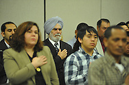 Immigrants listen to the national anthem before becoming U.S. citizensNaturalization Ceremony at the U.S. District Court in Oxford, Miss., on Thursday, December 20, 2012.