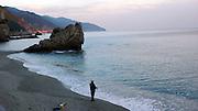 Fisherman on the beach, Monterosso al Mare, Italy.