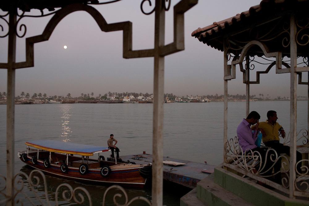A man sits on a boat on the Shatt al-Arab on Friday, October 22, 2010 in Basrah, Iraq.