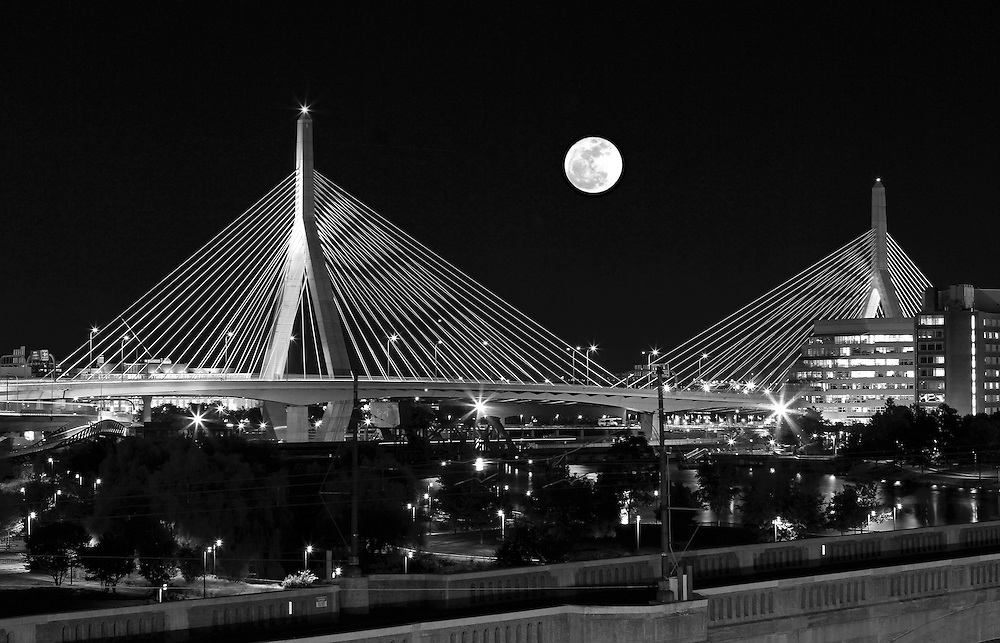 Black and White New England nature and astrology photography of a rising full moon over the historic Boston Bunker Hill Bridge in Charlestown, MA. This iconic bridge is better known as the Zakim Bridge that was erected as part of the Big Dig. It is always a special treat experiencing and photographing a full moon.<br /> <br /> Super moon is the next step up and the next one is expected 14 November 2016. A supermoon is known as a new or full moon occurring at the same time the moon comes within 90 percent of its closest approach to Earth in a given orbit. It is an astronomical event that happens 4-6 times a year, but according to a NASA Science News story, last nights full moon nearly coincided with the moon's arrival at its closest point in its orbit around the Earth, resulting in the biggest, visible full moon in North America in two decades. Next super moon to watch November 14, 2016 ... mark your calendars.<br /> <br /> B&amp;W Boston full moon photos are available as museum quality photography prints, canvas prints, acrylic prints or metal prints. Fine art prints may be framed and matted to the individual liking and decorating needs:<br /> <br /> http://juergen-roth.pixels.com/featured/full-moon-rising-over-boston-zakim-bridge-juergen-roth.html<br /> <br /> All Black and White Boston landmark photos are available for digital and print image licensing at www.RothGalleries.com. Please contact me direct with any questions or request.<br /> <br /> Good light and happy photo making!<br /> <br /> My best,<br /> <br /> Juergen<br /> Prints: http://www.rothgalleries.com<br /> Photo Blog: http://whereintheworldisjuergen.blogspot.com<br /> Instagram: https://www.instagram.com/rothgalleries<br /> Twitter: https://twitter.com/naturefineart<br /> Facebook: https://www.facebook.com/naturefineart
