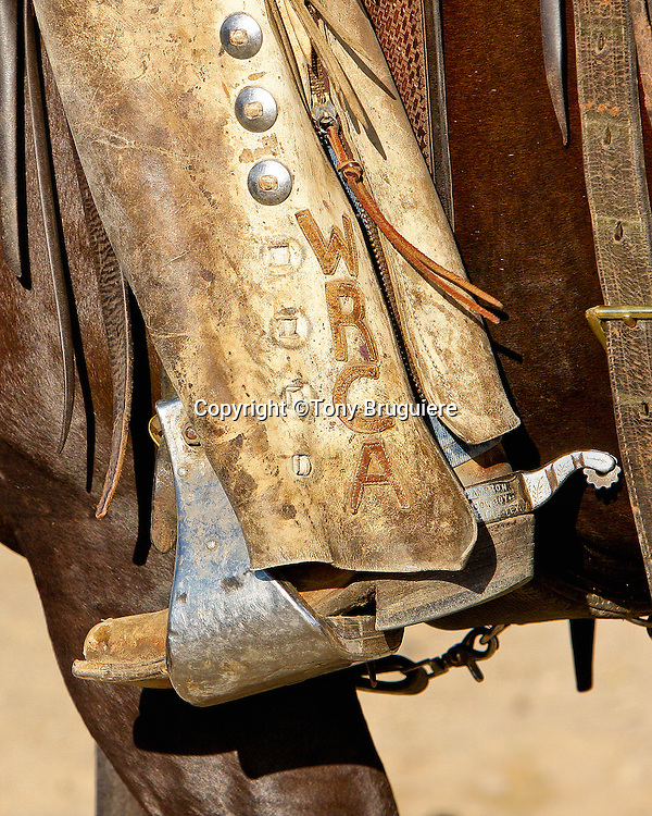 The boots, spurs, and chaps are functional pieces of equipment used every day by the American cowboy. As well as being functional they can be quite decorative and the spurs are often inlayed with silver or gold. A working cowboy and member of the Working Ranch Cowboys Association (WRCA) proudly wears silver inlayed trophy spurs.