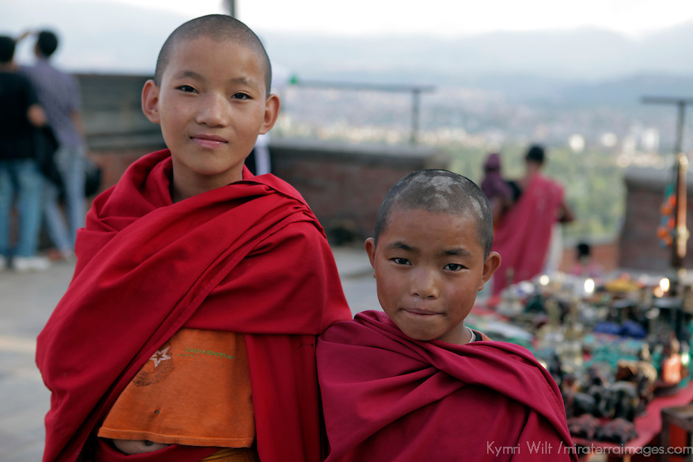 Asia, Nepal, Kathmandu.  Two young monks in robes.