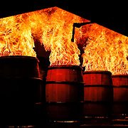 Oak barrels are charred on the insides while on the assembly line at the Brown-Foreman Cooperage celebrating their 70th anniversary.