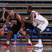 Delaware 87ers Forward Victor Rudd (23) defends Idaho Stampede Forward Jerrelle Benimon (50) in the second half of a NBA D-league regular season basketball game between the Delaware 87ers and the Idaho Stampede (Utah Jazz) Tuesday, Feb. 03, 2015 at The Bob Carpenter Sports Convocation Center in Newark, DEL