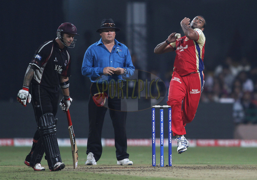 Raju Bhatkal of Royal Challengers Bangalore sends down a delivery during match 16 of the NOKIA Champions League T20 ( CLT20 ) between the Royal Challengers Bangalore and Somerset held at the  M.Chinnaswamy Stadium in Bangalore , Karnataka, India on the 3rd October 2011..Photo by Shaun Roy/BCCI/SPORTZPICS