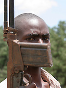 Ex-combattant in Burundi about to surrender his weapon and reitengrate normal life. Africa. @ Martine Perret. 24 October 2005