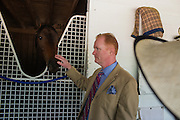 "Dr. Tom Childress with his horse ""Sultry Cat"" during The Kentucky Oaks at Churchill Downs in Louisville, Kentucky the day before the 140th Kentucky Derby on May 2, 2014."