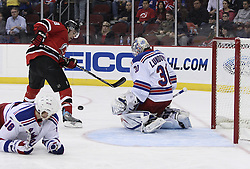 Mar 25, 2010; Newark, NJ, USA; New York Rangers goalie Henrik Lundqvist (30) makes a save on New Jersey Devils left wing Zach Parise (9) during the first period at the Prudential Center.