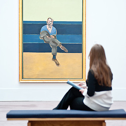 London, UK - 12 April 2013: A Sotheby's employee sits contemplating Francis Bacon's greatest painting of the love of his life, Peter Lacy (Est. $30-40 million). The work will go on sale at Sotheby's New York in May 2013. The Blockbuster sales at include works by Richter, Modigliani, Picasso, Rodin, Bacon, Cezanne.