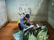 06 OCTOBER 2016 - BANGKOK, THAILAND:  A demolition worker takes apart a room in a home workers dismantled in Pom Mahakan. Evictions are continuing at a slow pace in Pom Mahakan Fort and as people move out their homes are destroyed to ensure new squatters don't move in. More than 40 families still live in the Pom Mahakan Fort community. Bangkok officials are trying to move them out of the fort and community leaders are barricading themselves in the fort. The residents of the historic fort are joined almost every day by community activists from around Bangkok who support their efforts to stay. City officials said recently that they expect to have the old fort cleared of residents and construction on the new park started by the end of 2016.     PHOTO BY JACK KURTZ