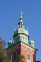 view from ground level looking up at wawel cathedral tower with sunshine and blue skies in september 2005