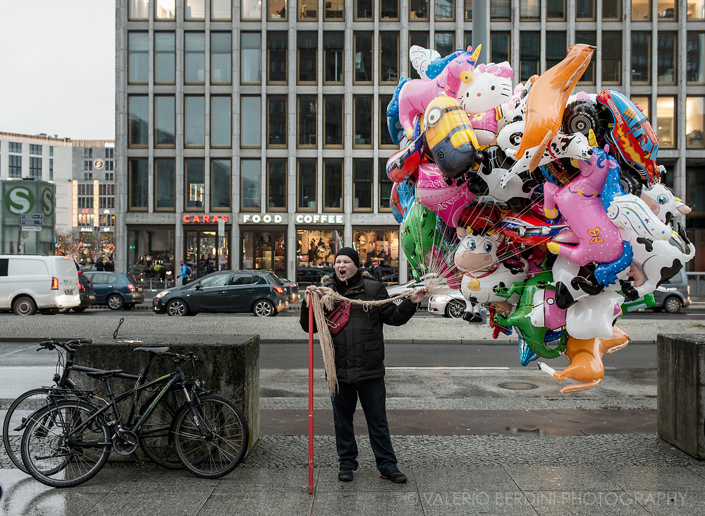 A balloons seller in Potsdamer platz in Berlin during Christmas festivities.