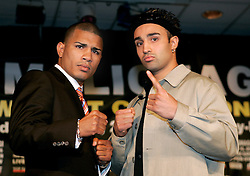 WBO Jr. Welterweight Champion, Miguel Cotto (l) and challenger Paulie Malignaggi (r) pose at the press conference announcing their June 10, 2006 fight at Madison Square Garden.
