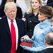 WASHINGTON, USA - January 20: Donald Trump takes the oat of office to become the 45th President of the United States of America during the 58th U.S. Presidential Inauguration in Washington, USA on January 20, 2017.