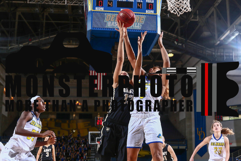 Army West Point Center Lena' Hicks (13) drives to the basket as Delaware Forward Makeda Nicholas (5) defends during a regular-season non conference game between Delaware and Army West Point Sunday, Dec. 11, 2016, at the Bob Carpenter Center in Newark Delaware.