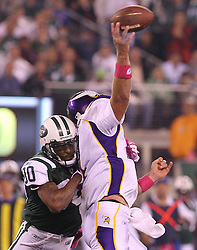 Oct 11, 2010; East Rutherford, NJ, USA; Minnesota Vikings quarterback Brett Favre (4) is hit by New York Jets cornerback Kyle Wilson (20) as he throws during the first half at the New Meadowlands Stadium.