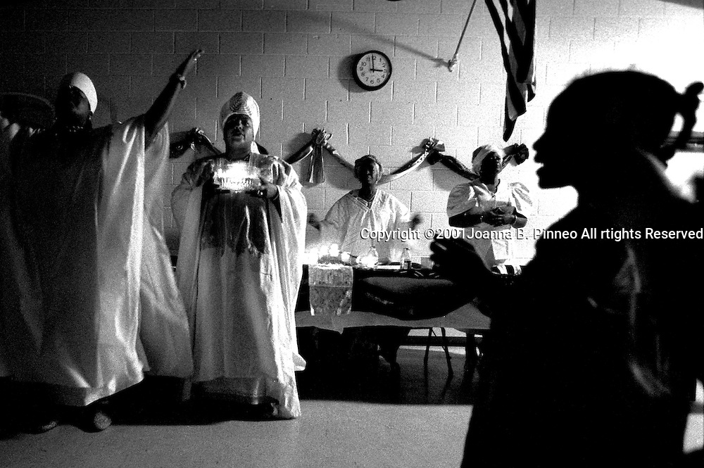 """Rites of passage programs for African American girls are springing up around the country. Elder Adjua Azusa Natoto-Z and her daughter Sarita Hawthorne lead a program for the Youth Empowerment Rites of Passage program of Richmond, Virginia. """"With sincere humbleness, gratitude and love,I take this oath of loyalty through dedication   Discipline, sacrifice and achievement,  to do all that I can in the way that I can to develop myself and my people. From the Rites of Passage Youth Empowerment Program Oath of Commitment by Emily Diane Gunter."""