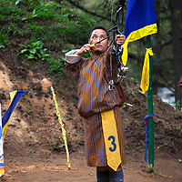 Asia, Bhutan, Bumthang. Bhutanese Archer with bow and arrow.