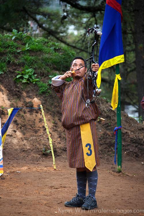 Asia, Bhutan, Bumthang. Bhutanese Archer with bow and arrow.