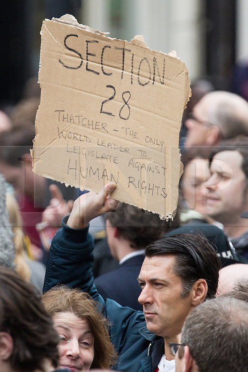 © Licensed to London News Pictures . 17/04/2013 . London , UK . A protester with a Section 28 protest placard at Ludgate Circus . The funeral of former British Conservative Prime Minister , Baroness Margaret Thatcher , today (Wednesday 17th April 2013) in Central London . Baroness Thatcher died from a stroke at the age of 87 . Photo credit : Joel Goodman/LNP