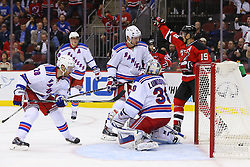 Oct 21, 2014; Newark, NJ, USA; New Jersey Devils center Travis Zajac (19) celebrates a goal by New Jersey Devils center Adam Henrique (14) (not shown) on New York Rangers goalie Henrik Lundqvist (30) during the second period at Prudential Center.