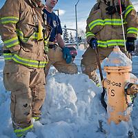 Anchorage Firemen, Paul Urbano, Andy Harvey, and Ryan Sorsdahl, shovel a fire hydrant on 15th Ave. near Cordova Street.