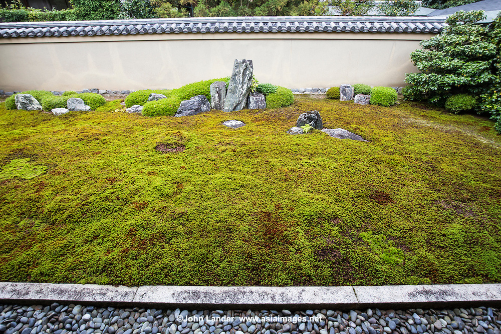 """""""Ishidani"""" is made up of moss and stones.  The largest patch represents a turtle, while the two smaller standing stones in the back make up """"Crane island"""" -  These two animals are often depicted in zen gardens. The two large standing stones represent Horaizan mountain.."""