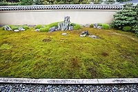 """Ishidani"" is made up of moss and stones.  The largest patch represents a turtle, while the two smaller standing stones in the back make up ""Crane island"" -  These two animals are often depicted in zen gardens. The two large standing stones represent Horaizan mountain.."