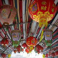 Asia, China, Hong Kong. Paper lanterns hang from traditional sampan in Aberdeen Harbour.
