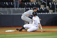 Mississippi's Preston Overbey (1) is safe as Auburn third baseman Damek Tomscha takes the throw at Oxford-University Stadium in Oxford, Miss. on Friday, April 4, 2014. (AP Photo/Oxford Eagle, Bruce Newman)