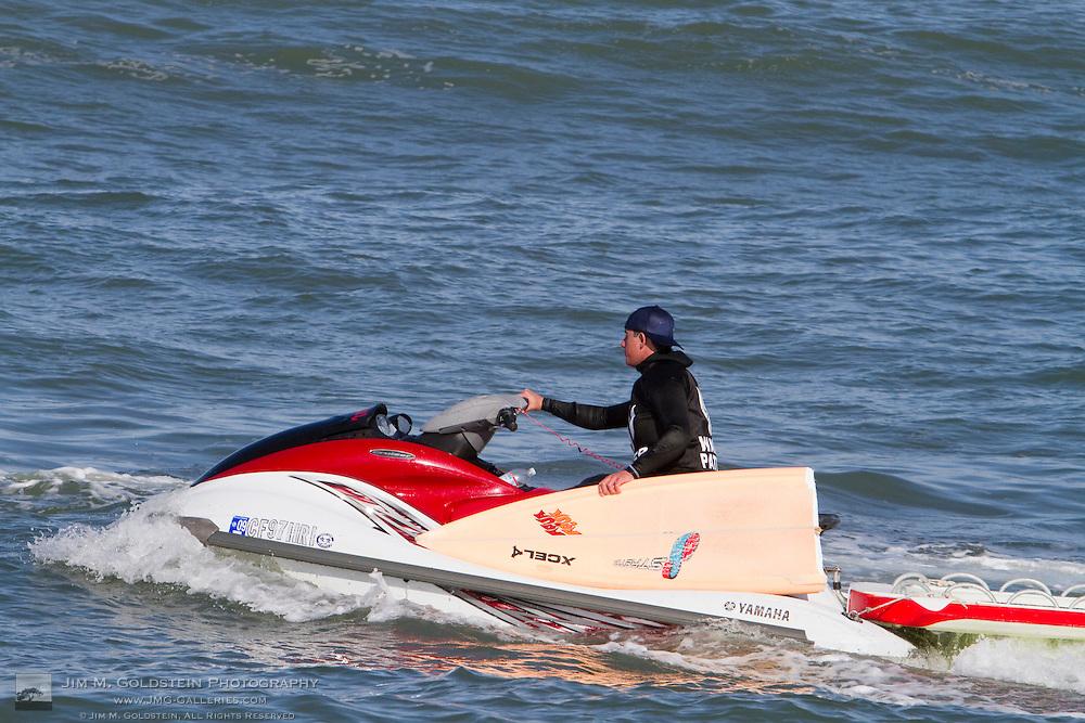 Mavericks Water Patrol picks up a broken surfboard at the Mavericks Surf Contest held in Half Moon Bay, California on February 13, 2010