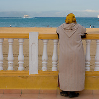 Woman facing beach in Morocco