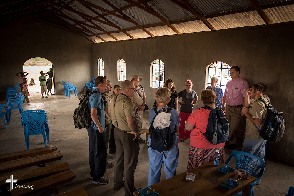 Members of the LCMS Mercy Medical Team meet and pray before clinic on Monday, June 20, 2016, in Nataparkakono, a village in Turkana, Kenya.  LCMS Communications/Erik M. Lunsford