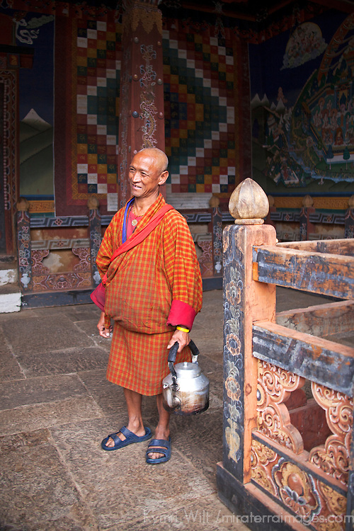 Asia, Bhutan, Trongsa. Monk with kettle at Trongsa Dzong.