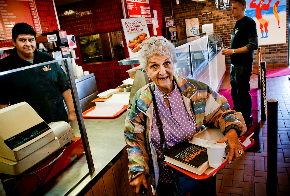 "Dorothy Urman at  ""U Lucky Dawg"", a hotdog restaurant that is a polling place in Chicago. She alrady voted for Obama. Manager Fabian Cruz behind the counter..Photographer: Chris Maluszynski /MOMENT"