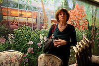 Kay LeRoy, widow of Warner LeRoy, the former owner of Tavern on the Green, in the Chrystal Room gives a tour of what is to be auctioned as the restaurant nears it's end. Pictured is a 45' oil painting dividing wall depicting scenes of Central Park..(Photo by Robert Caplin)..