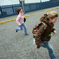 Two schoolgirls run back to class after an outing in Stanley, the capital of the Falkland Islands, on Wednesday, March 21, 2007. This year is the 25 anniversary of the war for sovereignty of the islands between the United Kingdom and Argentina. The two-month war resulted in the withdrawal of Argentinean forces and the islands remained part of the United Kingdom. After the war the on the islands there has been strong economic development. (Photo/Scott Dalton)