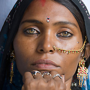 Although the eyes of this woman are exceptionally beautiful, having light coloured green eyes is not rare in the Thar desert of Rajasthan, India.