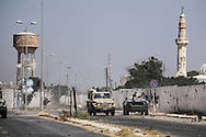 Two days after entering the capital, rebel Libyans launch an assault against  Bab Al Azizyia, Gadhafi's fortified compound in Tripoli. Amid fierce gunfire and shelling from loyalist defenders, rebels push toward the compound main gate on Al Jala'a street. The compound was successfully stormed that day. 23 August 2011.